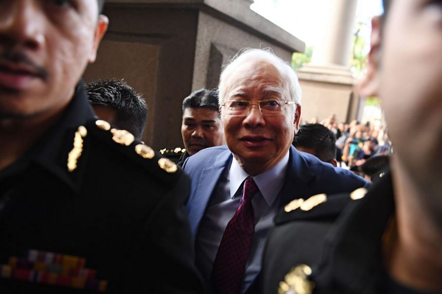 Former Malaysian prime minister Najib Razak (centre) arrives for a court appearance at the Duta court complex in Kuala Lumpur, on July 4, 2018.