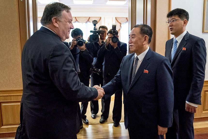 Secretary of State Mike Pompeo shaking hands with Kim Yong Chol (second from right) a North Korean senior ruling party official and former intelligence chief, in Pyongyang, on July 7, 2018.