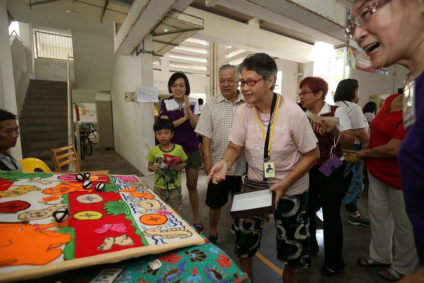 A senior citizen engaging in an activity as others look on, at the Senior Activity Centre at Rivervale, on July 7, 2018.
