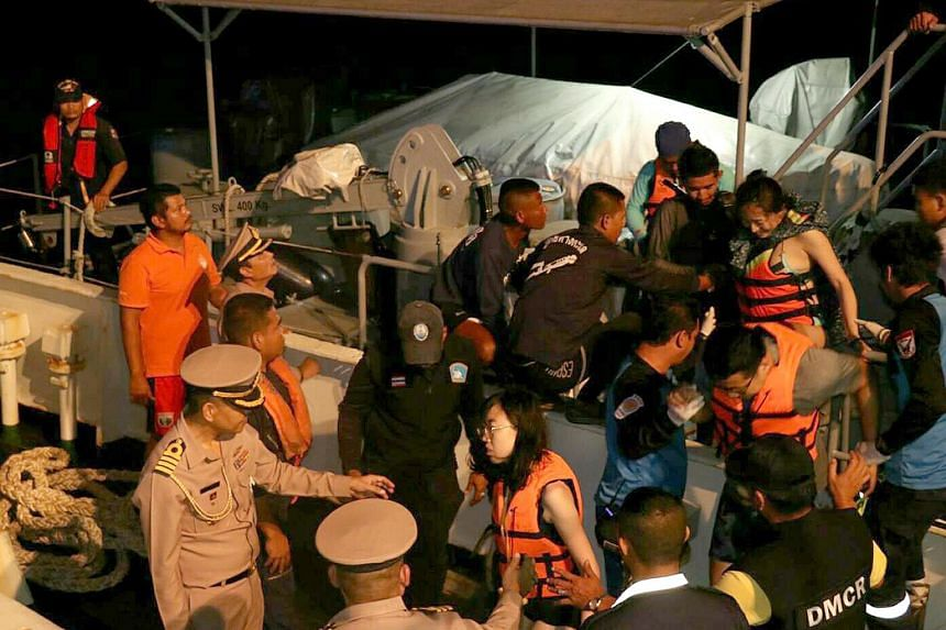 A photo by The Royal Thai Navy Third Area Command shows Thai Navy officials rendering assistance after a boat carrying Chinese tourists sank off Phuket, on July 5, 2018.