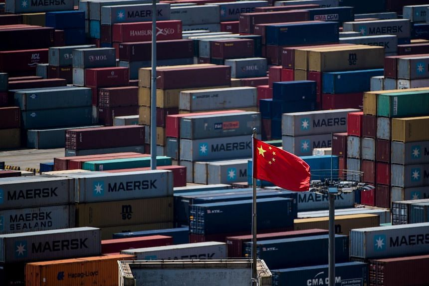 A Chinese flag in front of containers at the Yangshan Deep-Water Port, an automated cargo wharf, in Shanghai. In response to the US tariffs, Chinese Premier Li Keqiang indicated resolve on the part of the Chinese to meet any American move head-on.