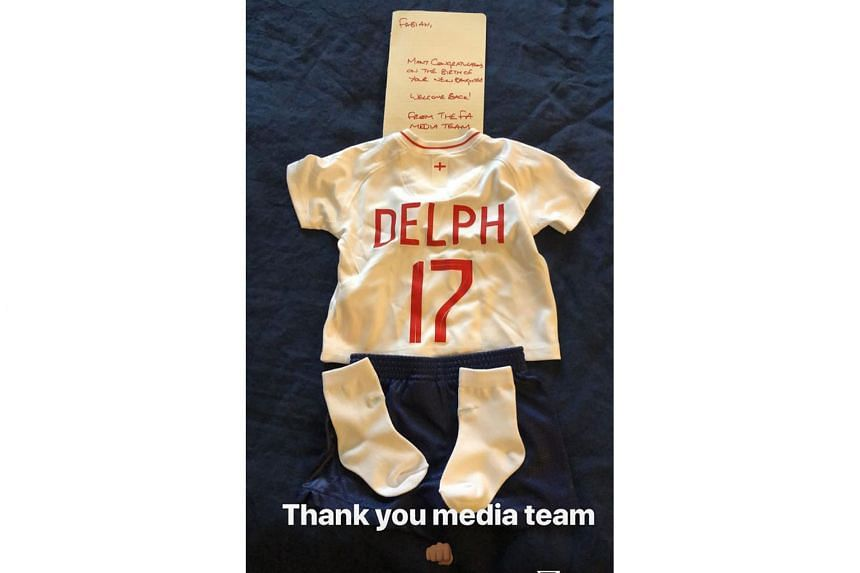 "SWEET TWEET The Football Association, giving Three Lions utility player Fabian Delph a baby England shirt with his name and number on the back to commemorate the birth of his third child. SAY WHAT? ""Nice tribute from London Underground..."" Alluding t"