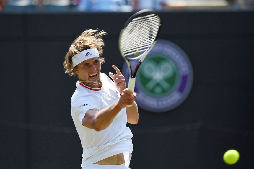 Alexander Zverev returning to American Taylor Fritz in their Wimbledon second-round match yesterday. The German reached the fourth round last year and is aiming to make the quarter-finals for the first time here.