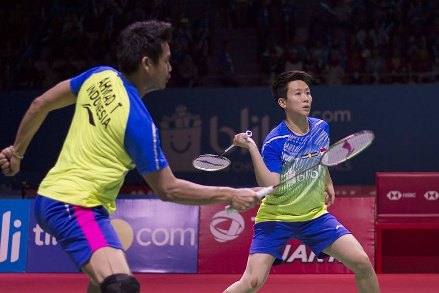 Liliyana Natsir and Tontowi Ahmad in the mixed doubles quarter-final match at the Indonesia Open yesterday, when they beat China's Zhang Nan and Li Yinhui. The Indonesian pair have withdrawn from the World Championships in China to focus on next mont