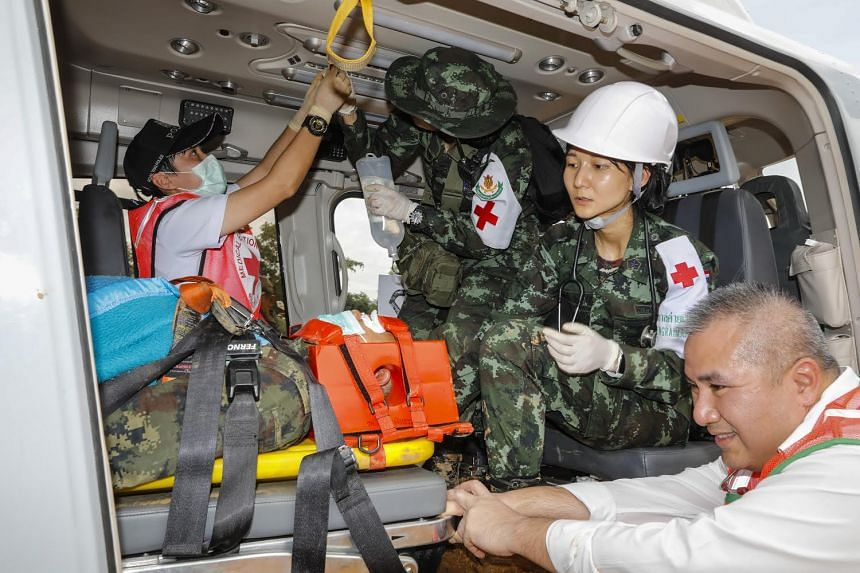 Thai rescue workers practise medical drills using a helicopter.