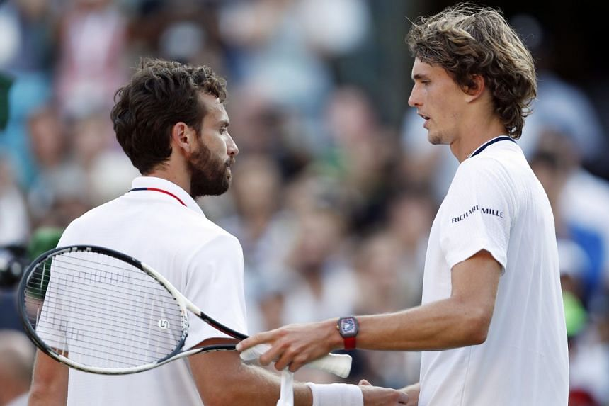 Ernests Gulbis of Latvia  at the net with Alexander Zverev of Germany after their match.