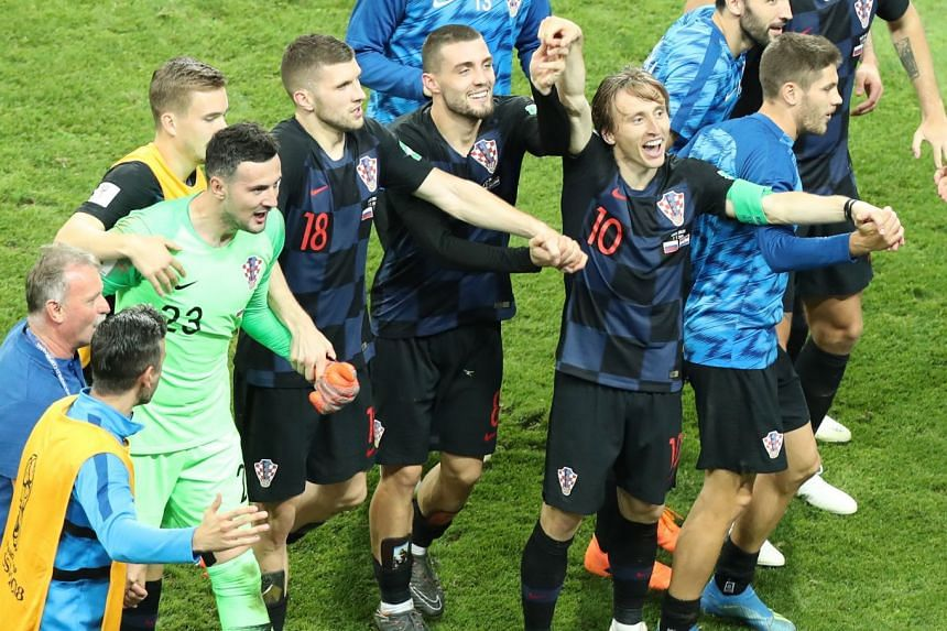 Luka Modric (second right) of Croatia celebrates after the match.