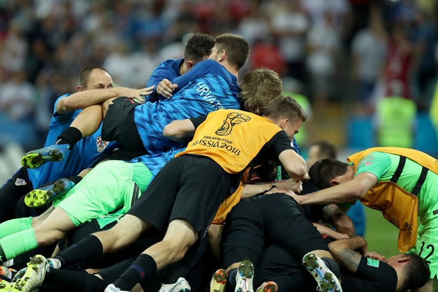 Croatia players celebrate winning the penalty shoot-out.
