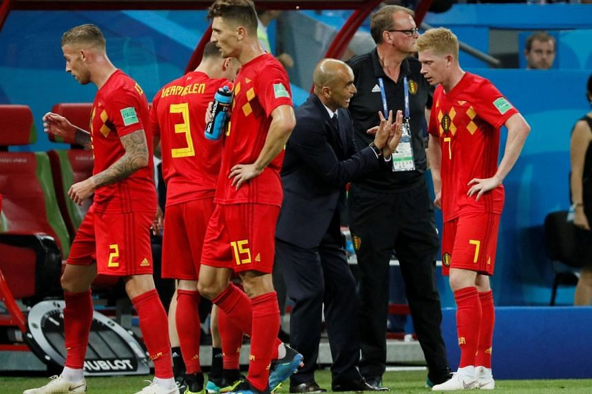 Belgium's Kevin De Bruyne speaks with Martinez as the players grab a drink during the match against Brazil.