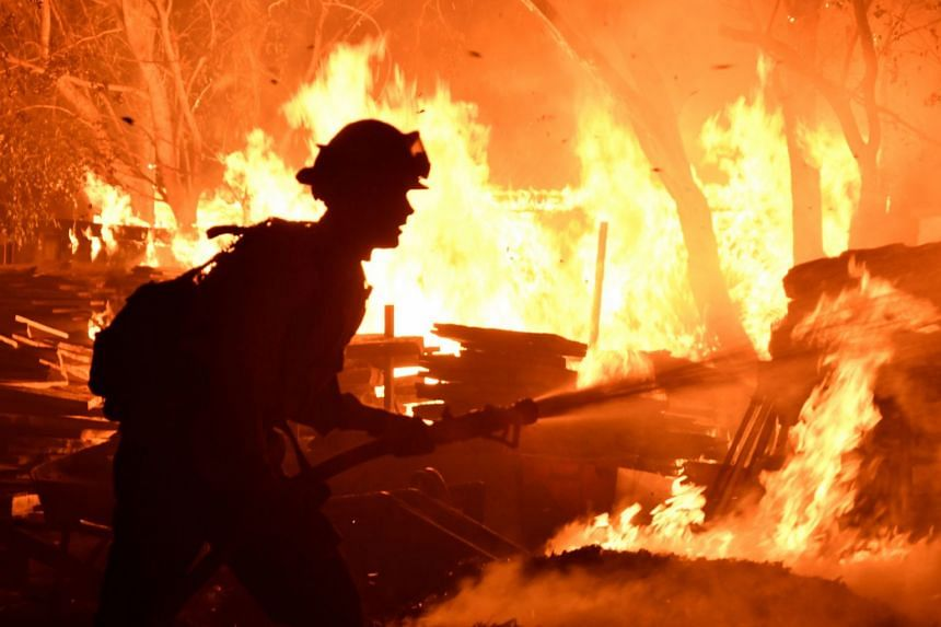 Firefighters battle a fast-moving wildfire that destroyed homes in Goleta, California.