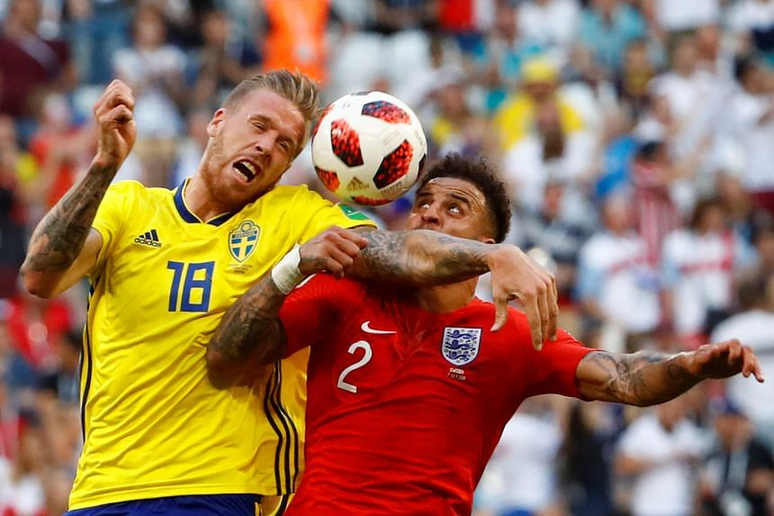 Sweden's Pontus Jansson in action with England's Kyle Walker.