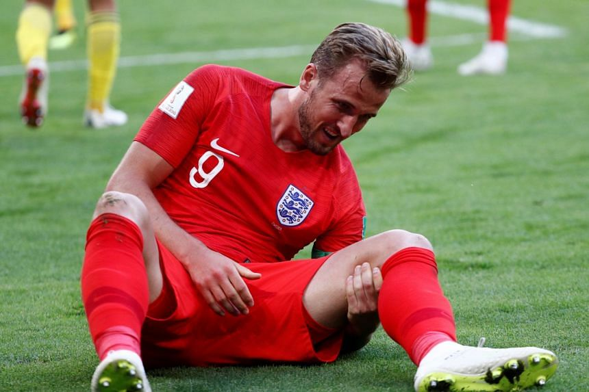 England's Harry Kane goes down after sustaining an injury.