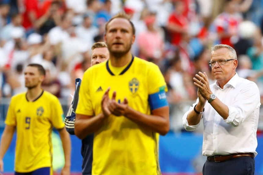 Sweden coach Janne Andersson and Andreas Granqvist applaud the fans at the end of the match.