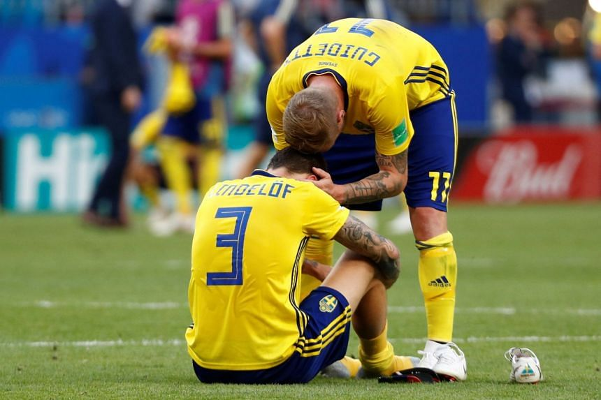 Sweden's Victor Lindelof and John Guidetti look dejected after the match.