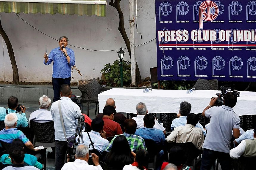 TV anchor Ravish Kumar speaking to a group of journalists at the Press Club of India in New Delhi in April. He has redefined Indian journalism by using his Hindi language programme to speak out for ordinary Indians who feel that every single institut