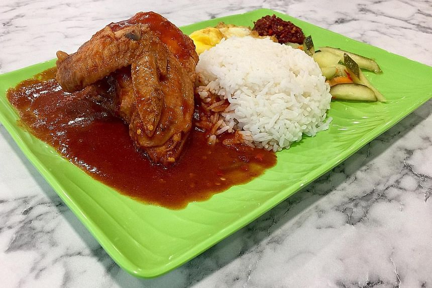 The ayam masak merah is delightfully spicy and tangy.