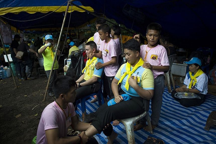 Volunteers also deliver and serve free food to all those involved in the massive rescue operation. Many Thais have been moved by the story of the trapped boys and their coach.