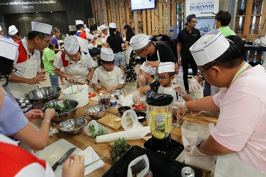 Some 50 employees of construction firm Samwoh Corporation attended a healthy cooking workshop yesterday as a build-up activity for The Straits Times Run on Sept 23. The workshop, helmed by Hed Chef Hedy Khoo, took place at cooking events company Cook