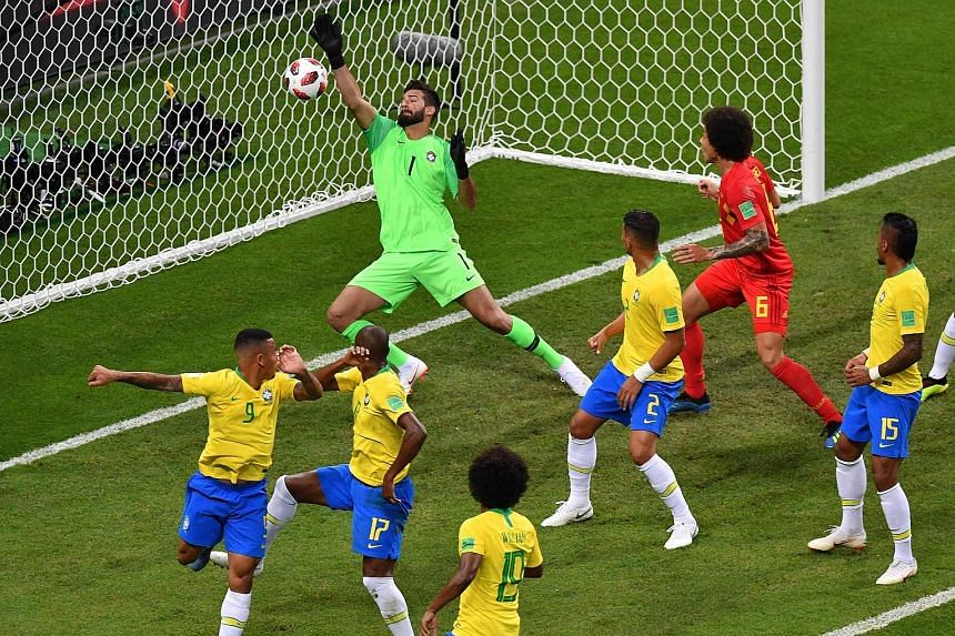 Brazil's goalkeeper Alisson fails to stop an own-goal by team-mate Fernandinho (17), while a distraught Neymar kneels and covers his face after his side are knocked out at the quarter-final stage on Friday. Many pundits believe Neymar's antics played