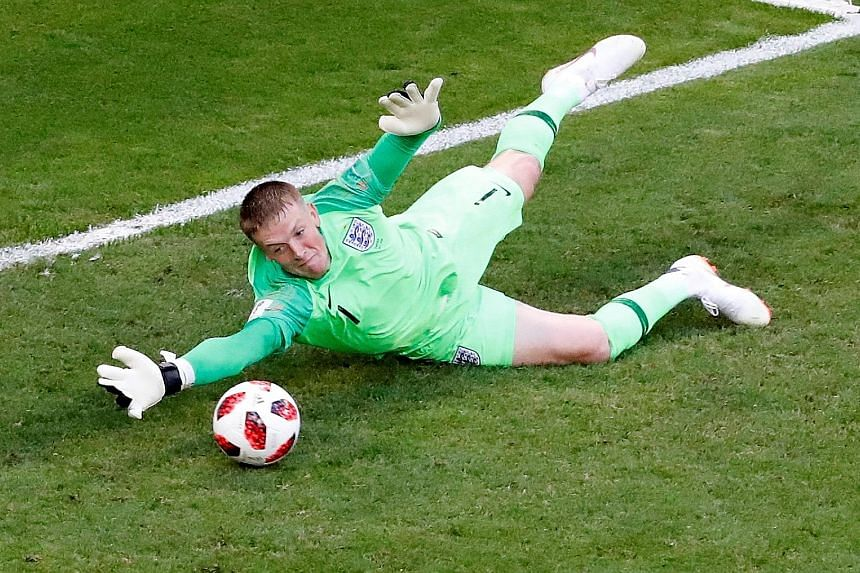 Top: Dele Alli putting England 2-0 up with a header. England goalkeeper Jordan Pickford contributing at the other end with one of his several saves to keep a first clean sheet in Russia.