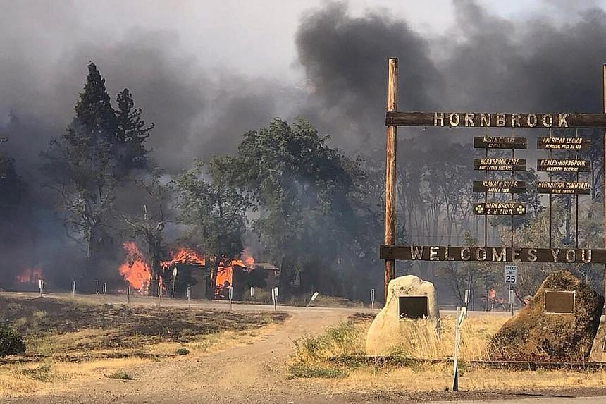 One person has died and more than 3,000 ha have burnt in the Klamathon fire, which broke out on Thursday near California's border with Oregon. It is one of dozens that have broken out across the western United States, fanned by scorching heat, winds