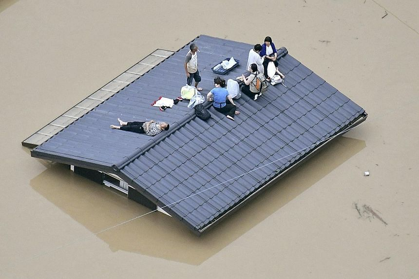 Pounding rain in Karatsu, Saga Prefecture, southwestern Japan, derailed a Japan Railways train. Japan's Meteorological Agency has issued special weather warnings urging vigilance against landslides, rising rivers and strong winds amid what it called