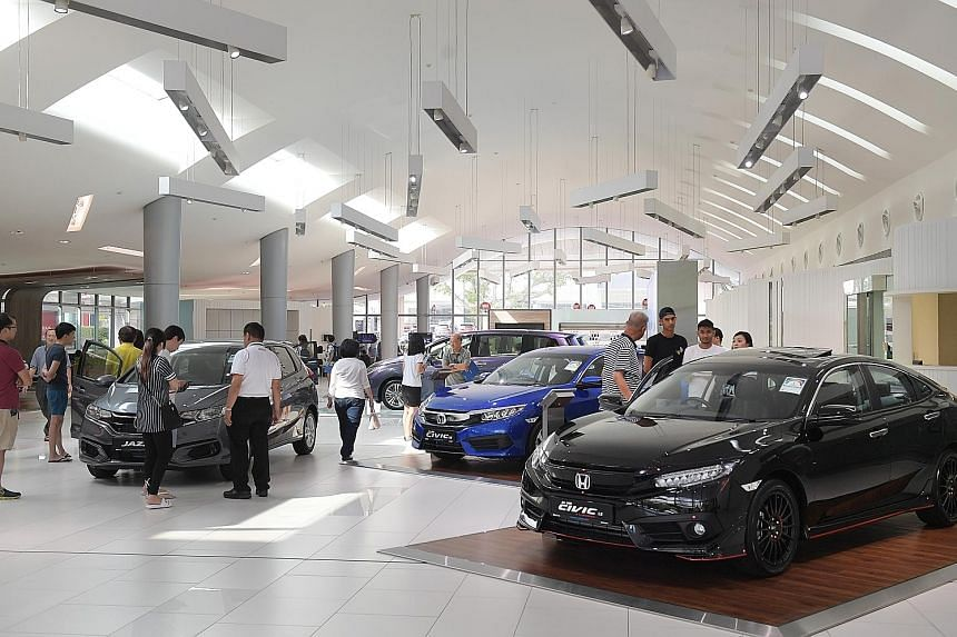 Showroom traffic was up by 30 per cent yesterday, said Mr Gary Quek, sales manager at Honda agent Kah Motor. Because of the lower COE premiums, Honda car prices have dropped by between $3,000 and $5,000, he added.