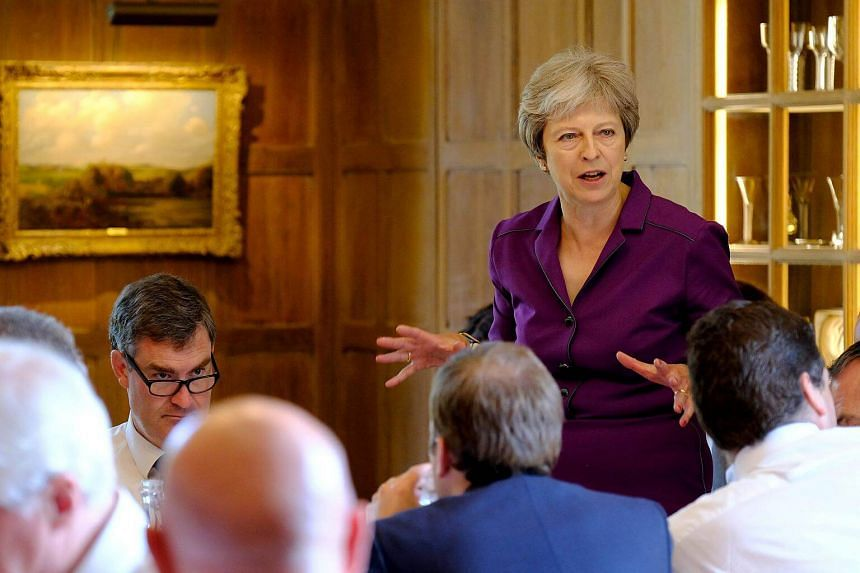 Britain's Prime Minister Theresa May commences a meeting with her cabinet to discuss the government's Brexit plans at Chequers, near Aylesbury, on July 6, 2018.
