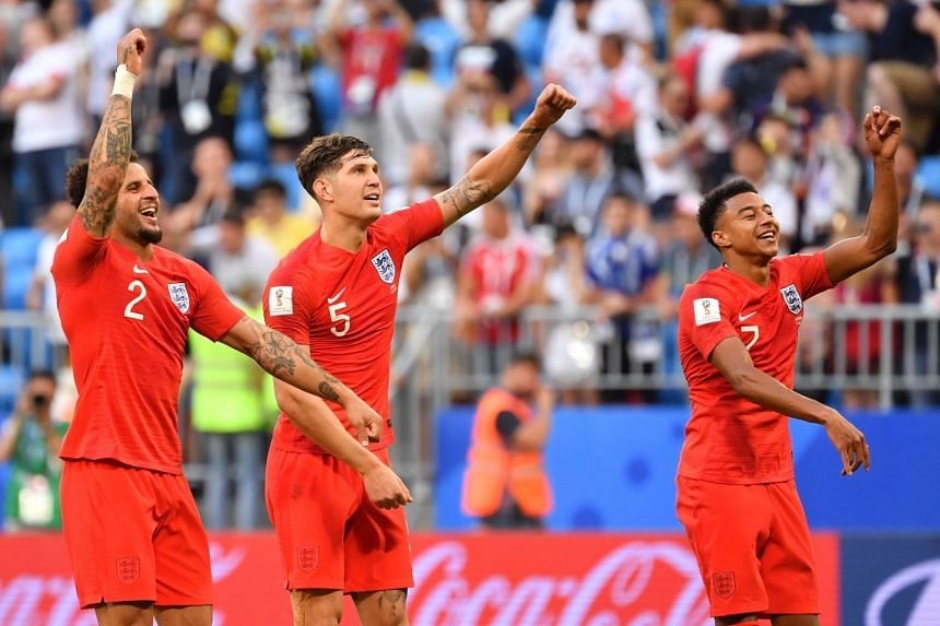 England's Kyle Walker, John Stones and Jesse Lingard celebrate at the end of the match.