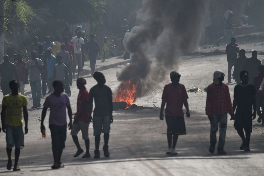 Protesters barricade a street in the Port-au-Prince suburb of Petion-Ville to protest against increases in fuel prices.