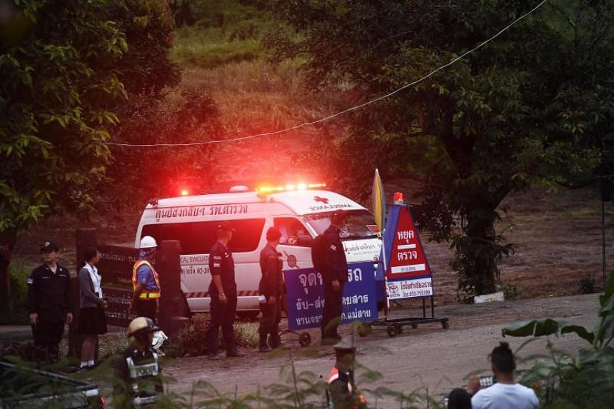 An ambulance leaves the Tham Luang cave area after divers evacuated some of the 12 schoolboys who are trapped inside the cave on July 8, 2018.