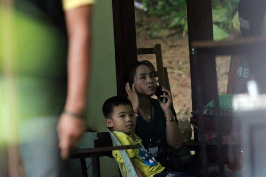 Family members of the schoolboys trapped inside Tham Luang cave in Thailand's Chiang Rai province wait in a room during rescue operations on July 8, 2018.