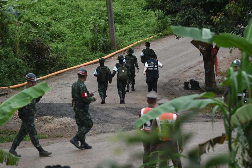 Thai military paramedics head to Tham Luang cave on July 8, 2018, as divers begin evacuation of some of the schoolboys who are trapped inside the cave.