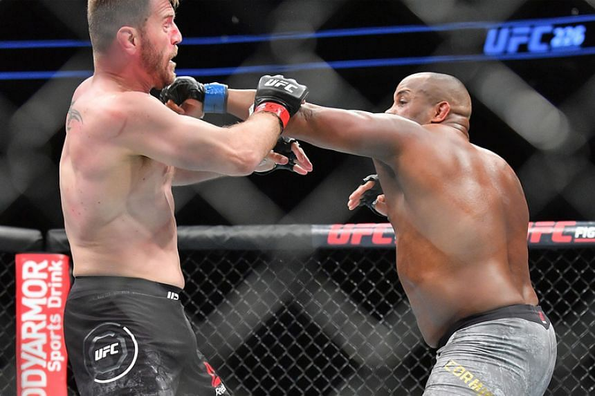 Daniel Cormier (right) throws a punch at Stipe Miocic during their heavyweight championship fight in Las Vegas on July 7, 2018.