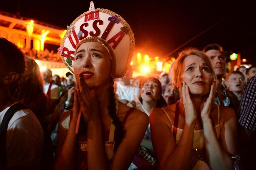 Russia fans watching the World Cup quarter-finals match between Russia and Croatia in Sochi on July 7, 2018.