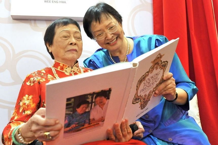 Mrs Wee Kim Wee and her daughter, Miss Wee Eng Hwa, unveiling their 544-page Peranakan cookbook - Cooking For The President: Reflections & Recipes Of Mrs Wee Kim Wee - at a book launch held at the Raffles Hotel in November 2010.