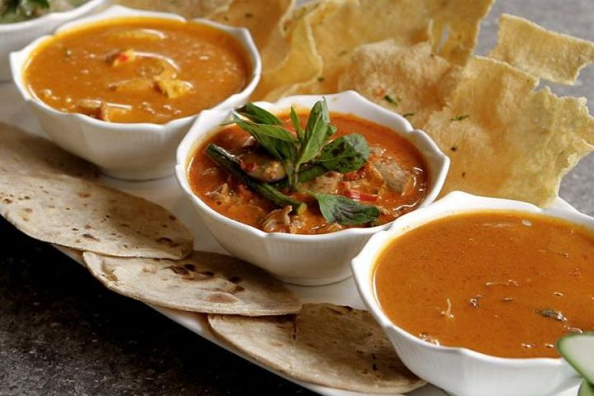The Curry Galore (RM52) with Thai red and green curry, Indonesian squid curry and Malaysian prawn curry served with chapati bread and cassava crackers.