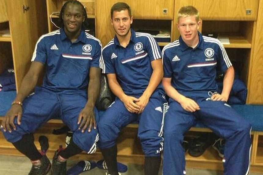 THROWBACK #1: And then there was one... at Stamford Bridge: Eden Hazard is the only member of the all-conquering three Belgian musketeers still at Chelsea, with Romelu Lukaku (left) now at Manchester United and Kevin de Bruyne (right) at Manchester C