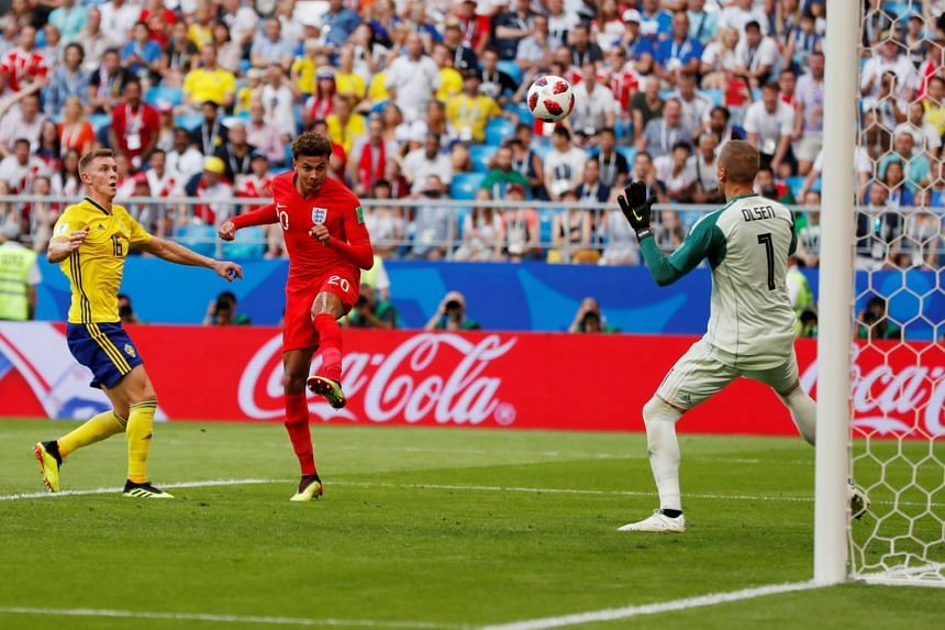 Above: Dele Alli putting England 2-0 up with a header.