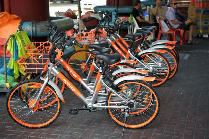 Mobike bicycles parked at Chinatown MRT station. Mobike, ofo, SG Bike and GBikes have submitted their applications to the Land Transport Authority for a full licence to operate dockless bicycle rental services.