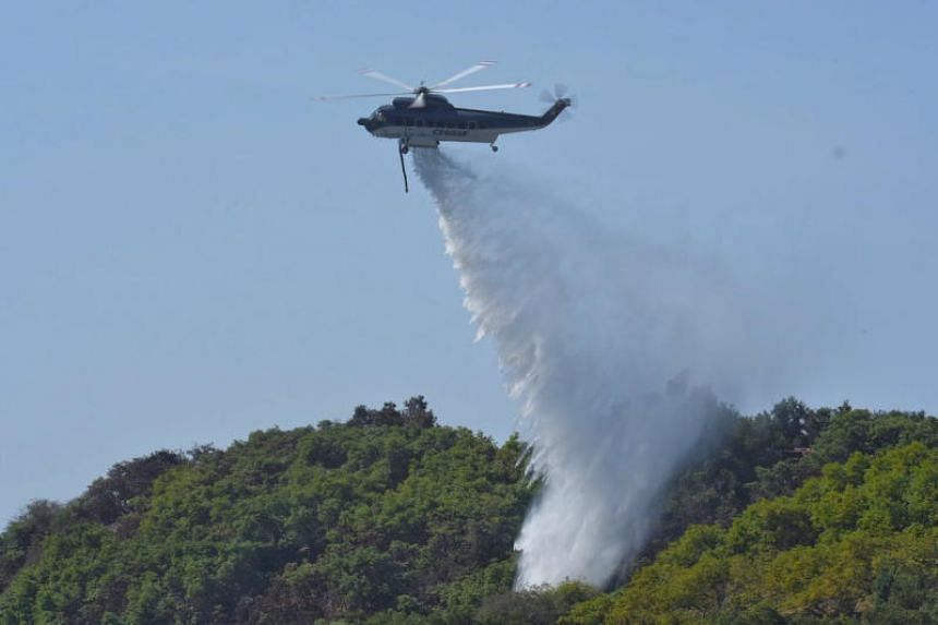A Croman Sikorsky S-61 helicopter making water drops on hot spots off Fairview Ave in Goleta, California, on July 7, 2018.