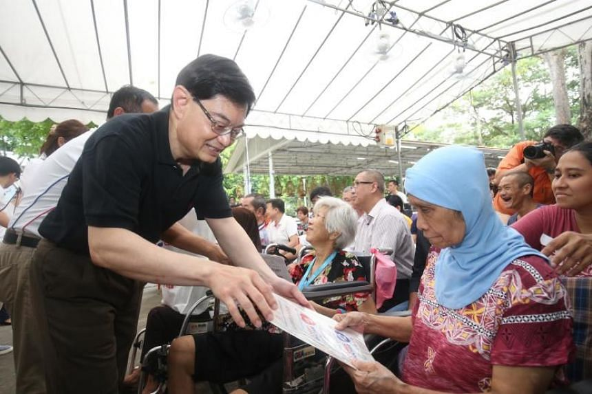 Finance Minister Heng Swee Keat visits the Workers' Party-held ward of Kaki Bukit in Aljunied GRC on July 8, 2018.