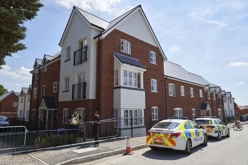 Police officers standing guard outside a residential house following the exposure of two people to a nerve agent, in Amesbury, England, on July 7, 2018.