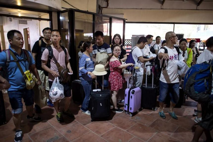 Tourists queueing at a jetty to leave Boracay, on April 25, 2018. The Philippines said it is looking at ways to shorten the processing of visas on arrival for Chinese visitors.