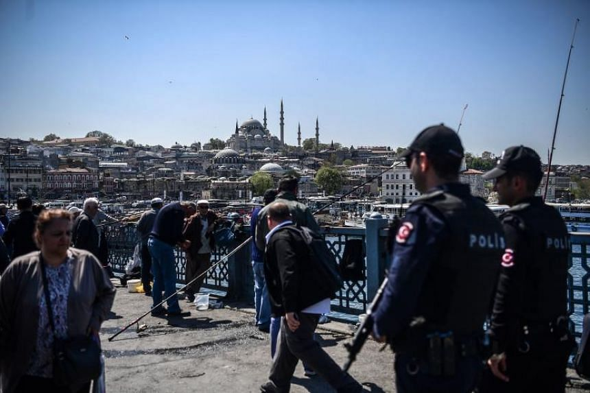 """The Official Gazette said 18,632 people including 8,998 police officers had been sacked in the emergency decree over suspected links to terror organisations and groups that """"act against national security""""."""