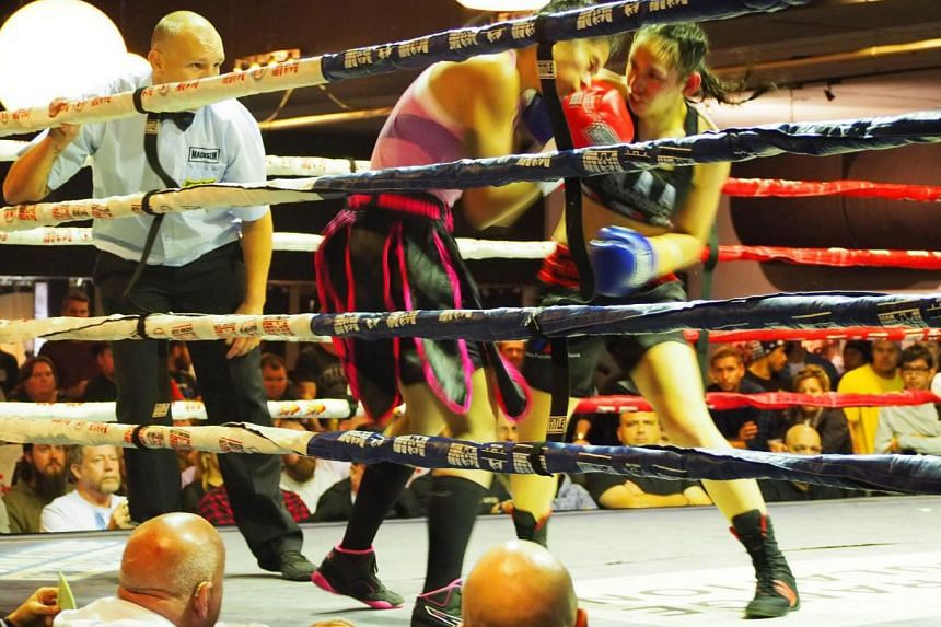Singapore's top female professional boxer Nurshahidah Roslie (left) lost on a unanimous decision her 10-round bout with Australian April Adams in Brisbane on July 7, 2018.