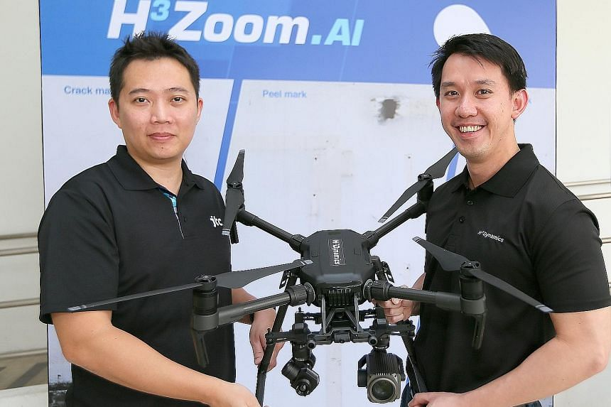 JTC director of building management Jason Foo (left) and H3 Zoom.AI chief technical officer and co-founder Shaun Koo with the H3 Zoom.AI Facade Inspector. Mr Foo said the ease of using the system will encourage building owners to check facades more f