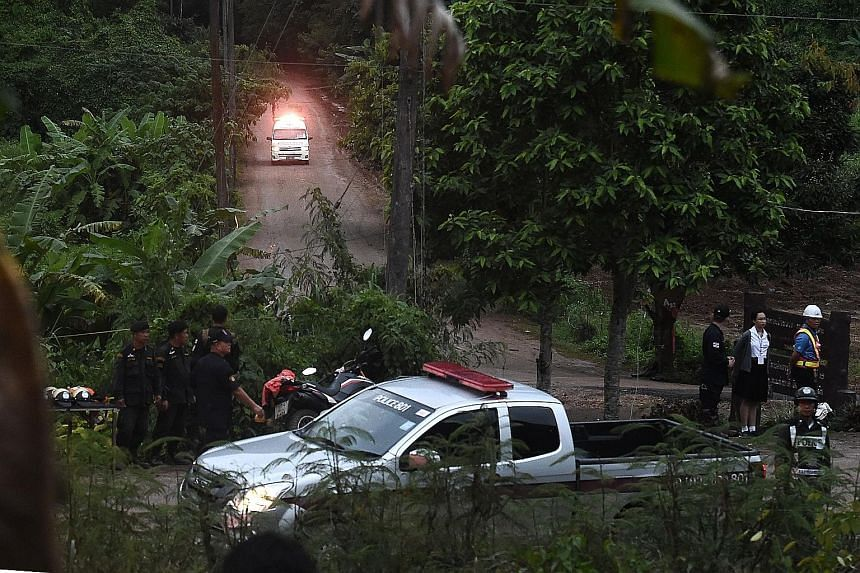 An ambulance leaving the Tham Luang cave area in Chiang Rai province after some of the boys were evacuated yesterday. The rescue operation was launched after several days of relatively mild weather, but weather forecasters have warned that heavy rain