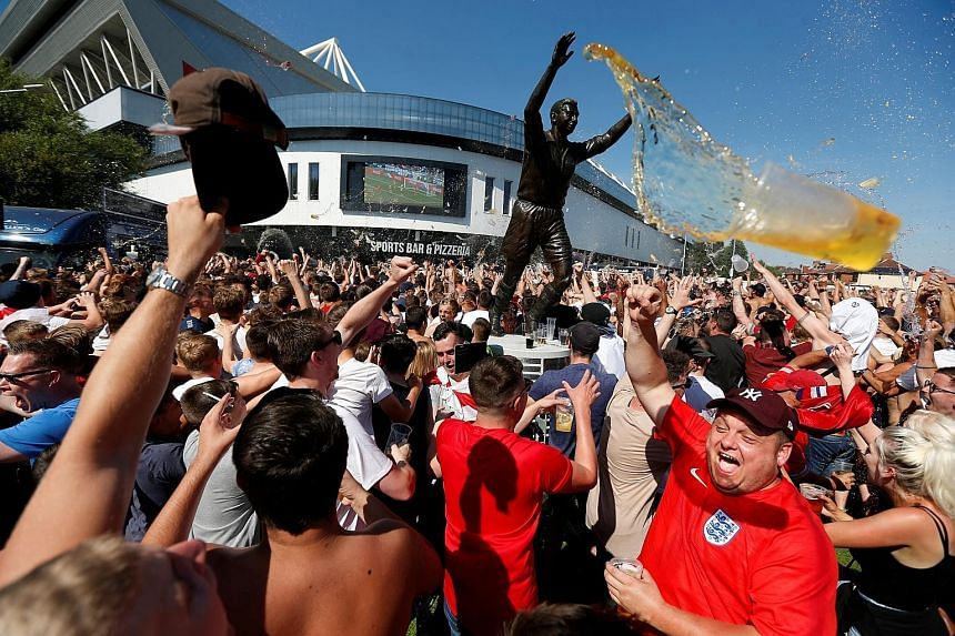 Clear weather prevails, but the forecast is for continuing beer showers as England fans celebrate outside Ashton Gate Stadium on Saturday.