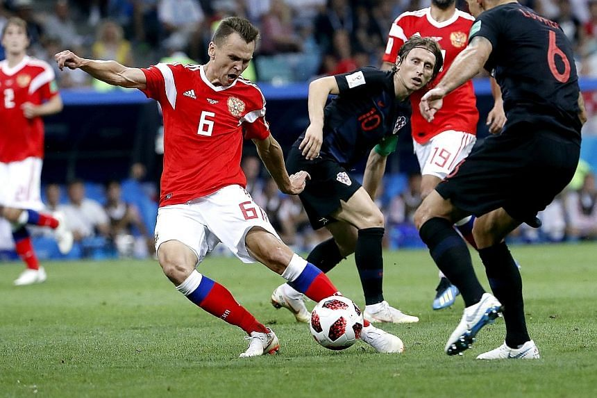 France defender Benjamin Pavard scoring in the 57th minute to make it 2-2 during the 4-3 victory against Argentina. His goal is widely regarded as one of the better strikes of the tournament so far. Below: Denis Cheryshev of Russia scores the opener